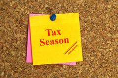 Tax season heading. On post-it pinned to cork board royalty free stock photos