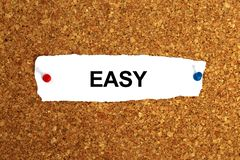 Easy word on white. Paper royalty free stock photo
