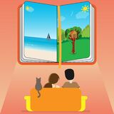Family sitting on a sofa and looking at an open book with landscapes