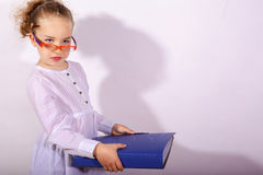 Basic school child with file in the hand and pencil behind the ear Royalty Free Stock Image