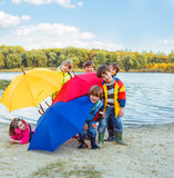 Basic school students in rainwear Royalty Free Stock Image