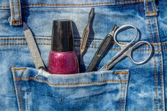 Basic set of manicure tools on jeans background Royalty Free Stock Photos