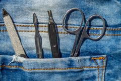 Basic set of manicure tools on jeans background Stock Images