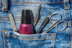 Basic set of manicure tools on jeans background Royalty Free Stock Image