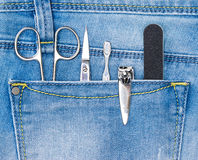 Basic set of manicure tools in jeans pocket Royalty Free Stock Images