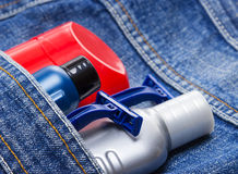 Basic skin care cosmetic products and accessories for men. Antiperspirant deodorant, shaving cream, aftershave lotion and disposable razors in jeans pocket stock photos