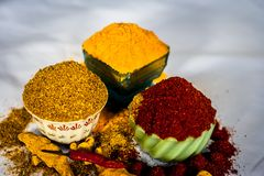 Basic spices of Indian food. Close up of three basic spices of Indian Asian food that are red pepper powder, turmeric powder and Dried coriander seed powder  on Royalty Free Stock Photo