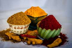 Basic spices of Indian food. Close up of three basic spices of Indian Asian food that are red pepper powder, turmeric powder and Dried coriander seed powder  on Stock Photos