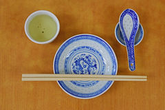 Basic tableware for a meal for Chinese. Which include cutlery and china with tea served Royalty Free Stock Images