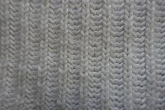 Basic white knitted fabric with rib stitch pattern. Vertical wales royalty free stock photo