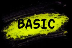 Basic word with glow powder. Basic word with yellow glow powder on black background stock image