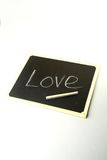 Basics lessons of Love. Love written on a blackboard Royalty Free Stock Image