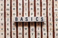 Basics word on building block. Concept royalty free stock photography