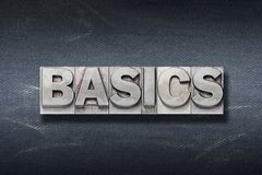 Basics word den. Basics word made from metallic letterpress on dark jeans background royalty free stock photos