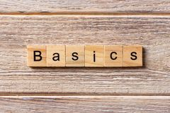 BASICS word written on wood block. BASICS text on table, concept stock photography