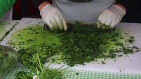 Basil being cut and chopped. Organic Basil being cut and chopped to make fresh pesto stock video footage