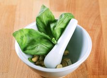 Basil and cashews in a mortar Stock Photo