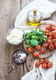 Basil, cherry-tomatoes, mozarella, olive oil Royalty Free Stock Photos