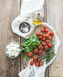 Basil, cherry-tomatoes, mozarella, olive oil Royalty Free Stock Photo