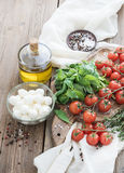 Basil, cherry-tomatoes, mozarella, olive oil Royalty Free Stock Photography
