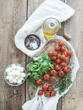 Basil, cherry-tomatoes, mozarella, olive oil Stock Photography