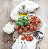 Basil, cherry-tomatoes, mozarella, olive oil Royalty Free Stock Image