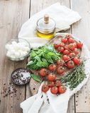 Basil, cherry-tomatoes, mozarella, olive oil Stock Images