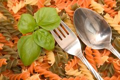 Basil, cutlery and pasta Stock Image