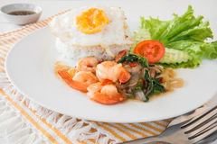 Basil fried rice with shrimp and fried egg (Pad kra prao kung), Royalty Free Stock Images