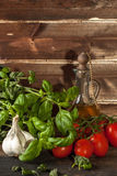 Basil, garlic and tomatoes Stock Photo