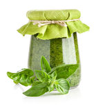 Basil and Glass jar of pesto sauce Stock Images