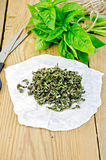 Basil green fresh and dry on paper Royalty Free Stock Photography