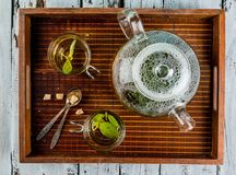 Basil herbal tea on wooden table Royalty Free Stock Photo