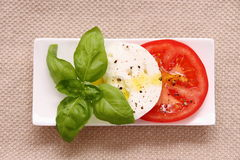 Basil leaf, mozzarella cheese, tomato slice Royalty Free Stock Images