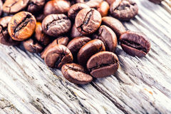 Coffee beans on grunge wooden background. Royalty Free Stock Photography