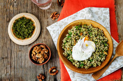 Basil nuts pesto quinoa with walnuts, parsley and poached egg Royalty Free Stock Photos