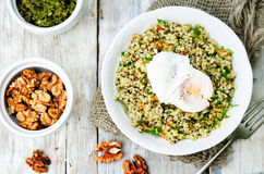 Basil nuts pesto quinoa with walnuts, parsley and poached egg Stock Image