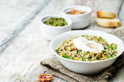 Basil nuts pesto quinoa with walnuts, parsley and poached egg Royalty Free Stock Images