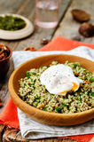 Basil nuts pesto quinoa with walnuts, parsley and poached egg Royalty Free Stock Photography