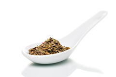 Basil (Ocimum basilicum) on porcelain spoons Stock Image