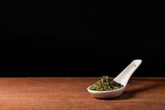 Basil (Ocimum basilicum) on a spoons Stock Image