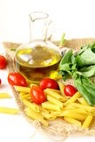 Basil, pasta and olive oil Royalty Free Stock Photography