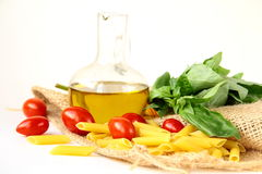 Basil, pasta and olive oil Stock Images