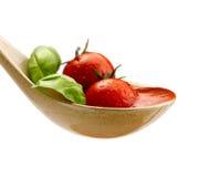 Basil pasta and tomato sauce stock photo