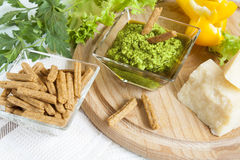 Basil pesto with bread rusks parmigiano cheese fresh yellow pepper lettuce leaves parsley Stock Photos