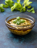 Basil pesto in a glass bowl Royalty Free Stock Photography