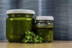 Basil pesto. Green delicious basil pesto with fresh basil Stock Photos