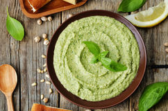 Basil pesto hummus. On a dark wood background. the toning. selective focus royalty free stock image