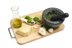 Basil pesto ingredients and utensils stock image
