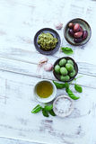 Basil Pesto, Olives, Sea Salt and Olive Oil Stock Photos